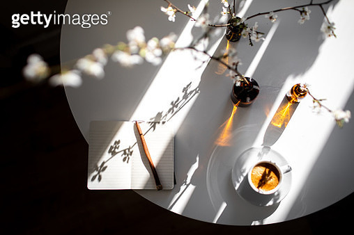 Small empty planner with coffee espresso and flowering cherry branches on white table in sunlight spring morning. How to start and planning perfect day. - gettyimageskorea