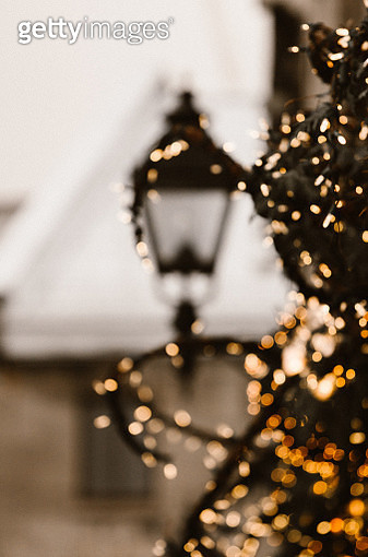 A street lamp with a christmas lights - gettyimageskorea
