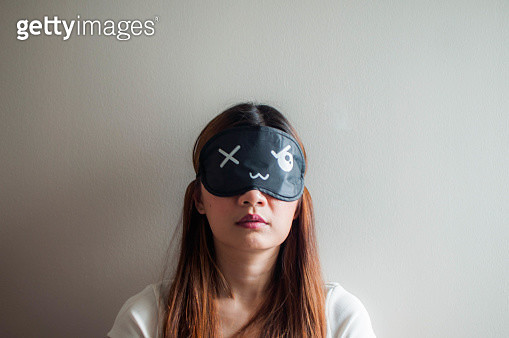 A portrait of a woman with sleeping mask - gettyimageskorea