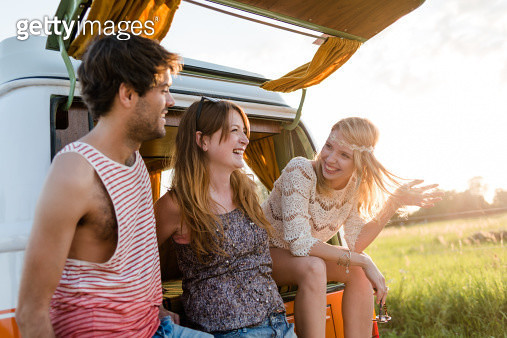 Young People Chatting Backside Of A Camping Bus - gettyimageskorea