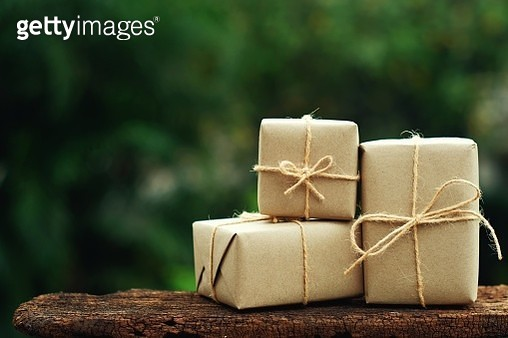 Close-Up Of Gift Boxes On Wood Outdoors - gettyimageskorea