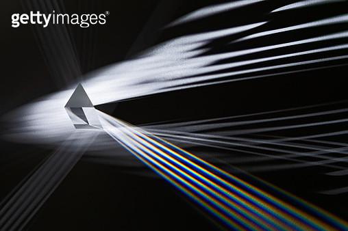 Triangular Prism Refracting Striped Light in The Dark. - gettyimageskorea