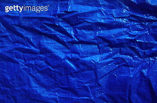 Crumpled blue plastic tarpaulin - gettyimageskorea
