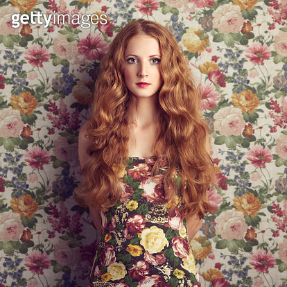 Beautiful girl on a floral background. - gettyimageskorea