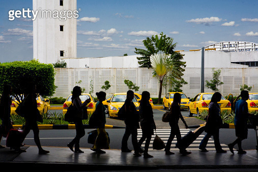 Travelers Waiting for Transportation at Airport - gettyimageskorea