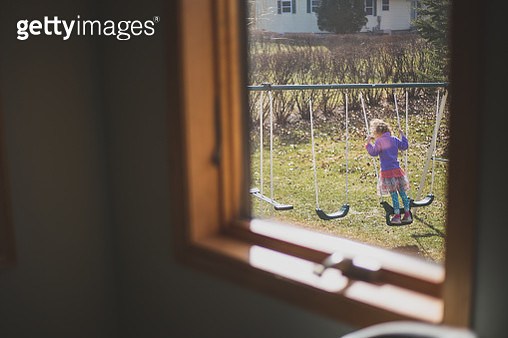 Child on a backyard Swing Set - gettyimageskorea