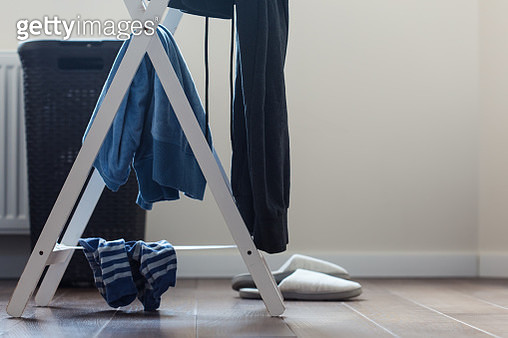 Clothes on rack and slippers - gettyimageskorea