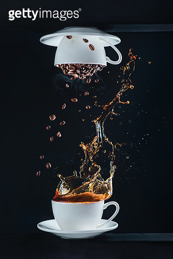 Coffee cup upside down, splash and falling coffee beans on a dark background - gettyimageskorea