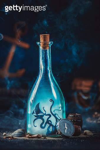 Sea monster in a glass bottle, adventure and sea travel concept - gettyimageskorea