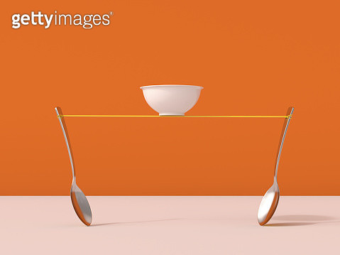 bowl balances on cord taut between two spoons - gettyimageskorea