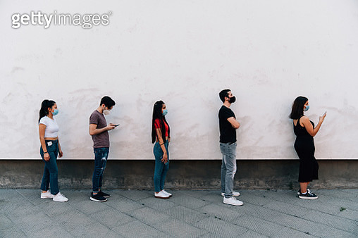 People waiting in line to enter in a store - Social distancing concept - gettyimageskorea