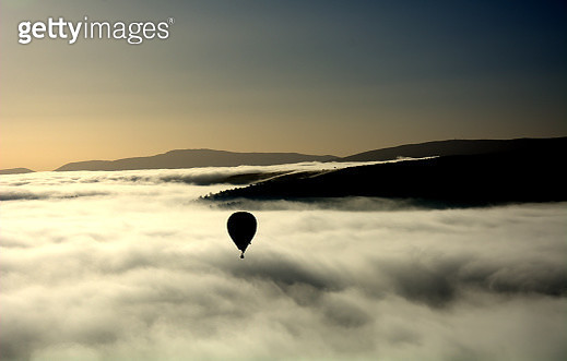 Flying with a balloon - gettyimageskorea