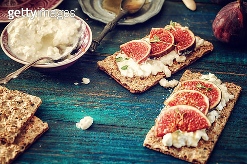 Crispbread with Serrano Ham, Cottage Cheese, and Figs - gettyimageskorea