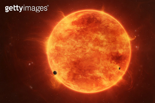 A massive red dwarf consuming planets within it's range. - gettyimageskorea