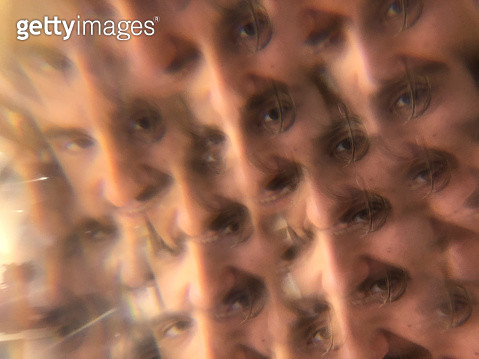 Multiple image of a male portrait through a prism - gettyimageskorea