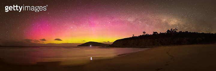 Colourful Aurora Australis and Milky Way Panorama over beach scene - gettyimageskorea