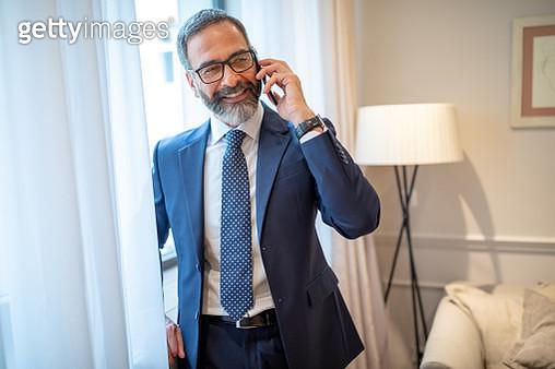 Businessman talking on the phone - gettyimageskorea