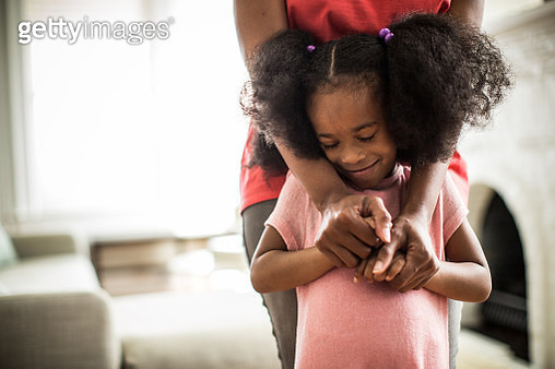 mother's arms embracing daughter - gettyimageskorea