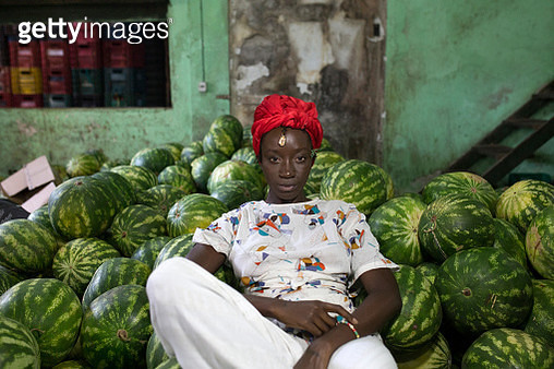 An Afro-Brazilian woman visits the São Joaquim Market in Salvador. - gettyimageskorea