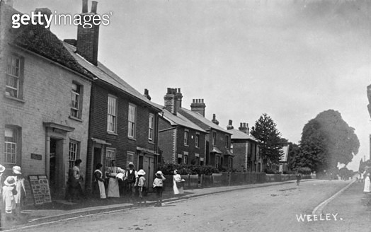 Street scene in the village of Weeley, Essex, with a group of people on the left. - gettyimageskorea