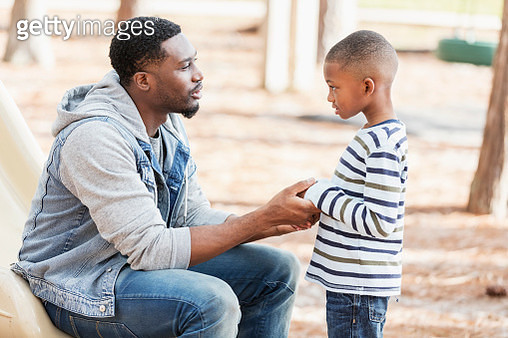 Father talking to little boy on playground - gettyimageskorea