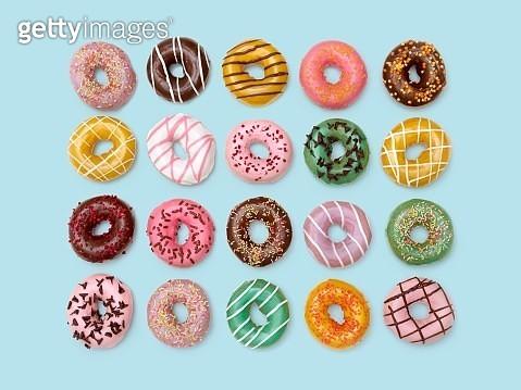 Colourful doughnuts, studio shot. - gettyimageskorea