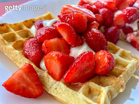 Strawberries (Charlotte kind) served on a bed of Yogurt and  waffle - gettyimageskorea