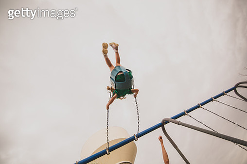 Child Swinging High Into the Air - gettyimageskorea