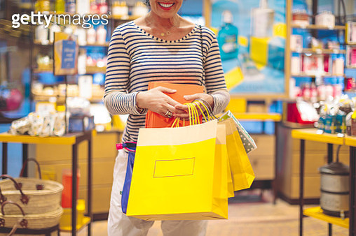 Woman is buying presents at the shopping mall - gettyimageskorea