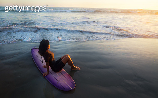 Woman and Surfboard - gettyimageskorea