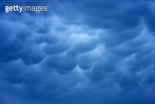 Cumulus clouds with during rianing ,Clouds eflextion on during sunset - gettyimageskorea