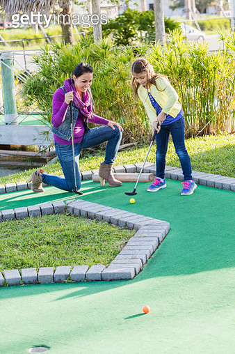 Moher and daughter playing miniature golf - gettyimageskorea