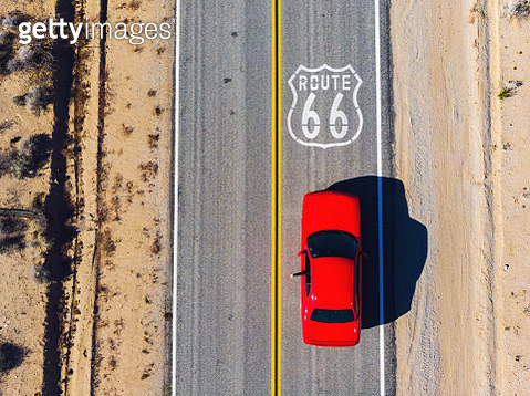 Drone view of American car driving in a straight road of the famous Route 66. - gettyimageskorea