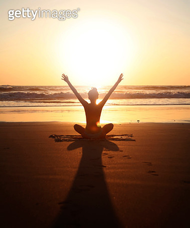 Sunset arms raised yoga pose - gettyimageskorea