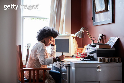 Portrait of woman with cool hair in home office - gettyimageskorea