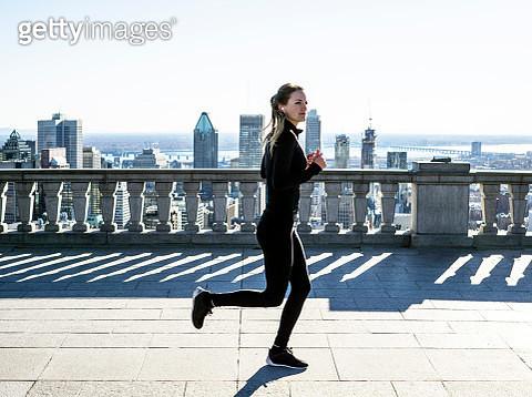 Caucasian woman running in city - gettyimageskorea