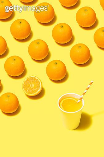 Orange juice flat lay on yellow background - gettyimageskorea