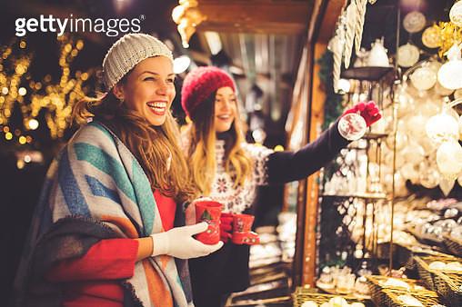 Buying on Christmas market - gettyimageskorea