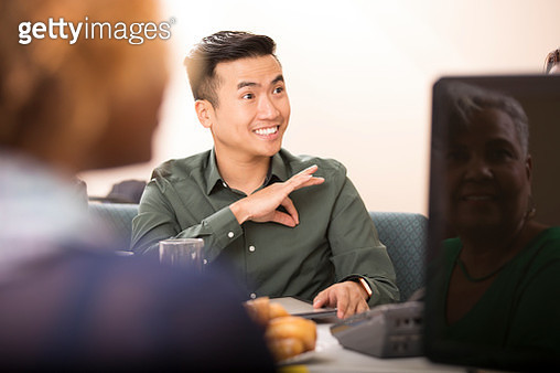 Business man signing during team meeting. - gettyimageskorea