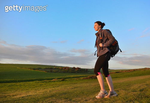 Young female hiker, hiking in hills - gettyimageskorea