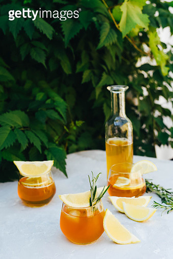 Chilling lemonade with rosemary in a beautiful glass. - gettyimageskorea