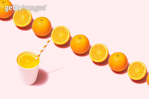 Orange juice and oranges flat lay on pink background - gettyimageskorea