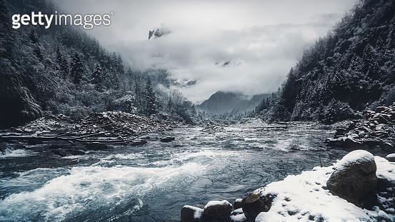 Rapid mountain river flowing through valley in winter, Ganzi, Sichuan, China - gettyimageskorea