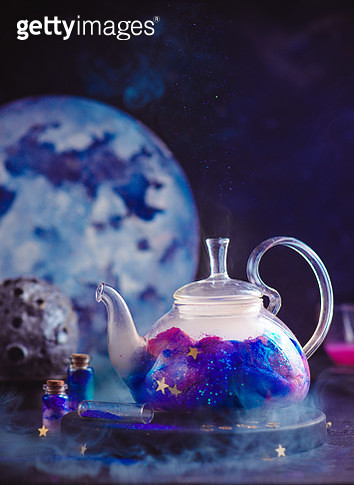 Glass teapot with a galaxy, astronomy still life with copy space - gettyimageskorea