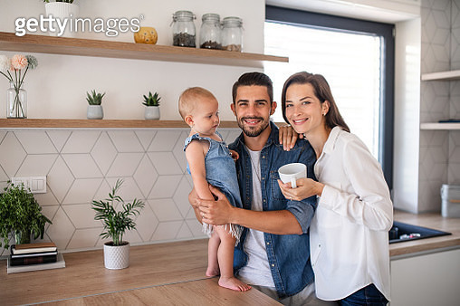Father, mother and lilttle daughter looking at camera. - gettyimageskorea