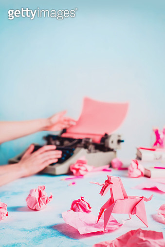 Pink origami unicorn with crumpled paper balls, searching for ideas, creative writing concept - gettyimageskorea