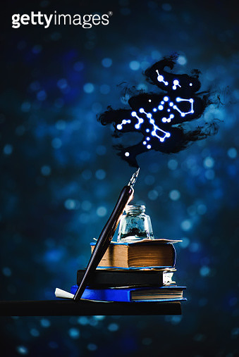Inkwell and pen with stars and constellations. Astronomy and magic, writing concept - gettyimageskorea