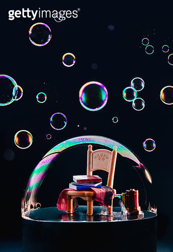 Isolation concept, a chair with books under a dome of soap bubbles - gettyimageskorea