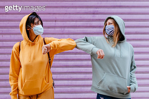 Young woman wearing masks greeting with elbow - gettyimageskorea