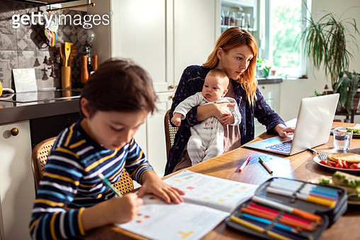 Young Family in the Kitchen - gettyimageskorea